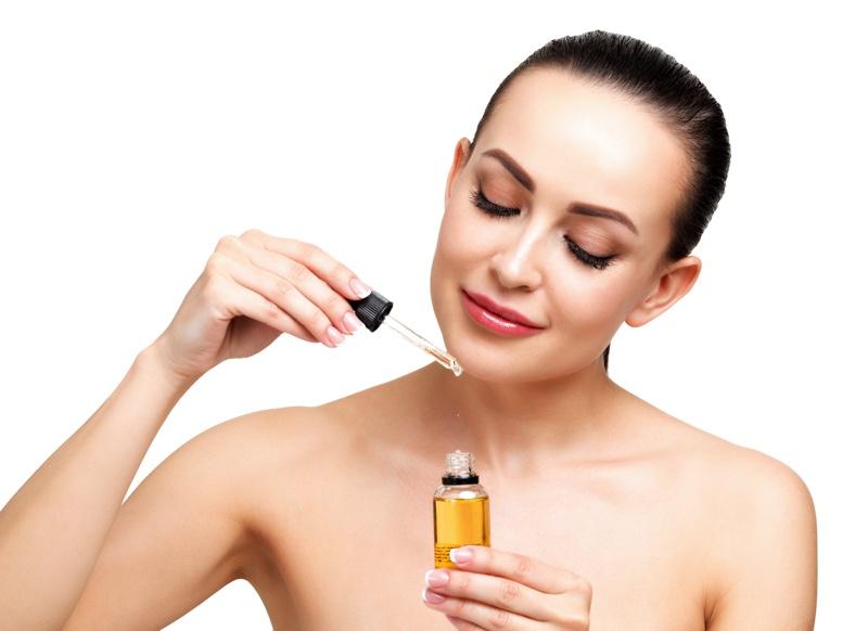 Woman Holding Oil Bottle Beauty