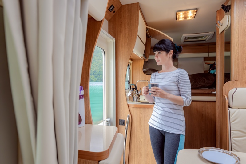 Woman Interior RV Holding Coffee Cup
