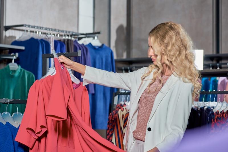Woman Selecting Dresses