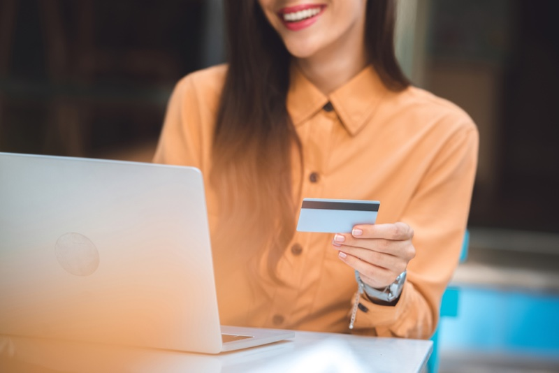Woman Shopping Laptop Smiling Credit Card