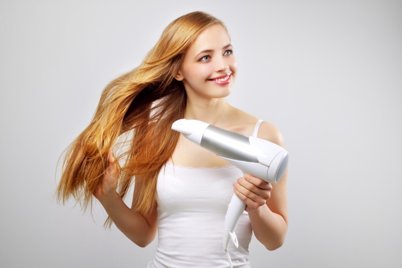 Woman Smiling Hair Dryer