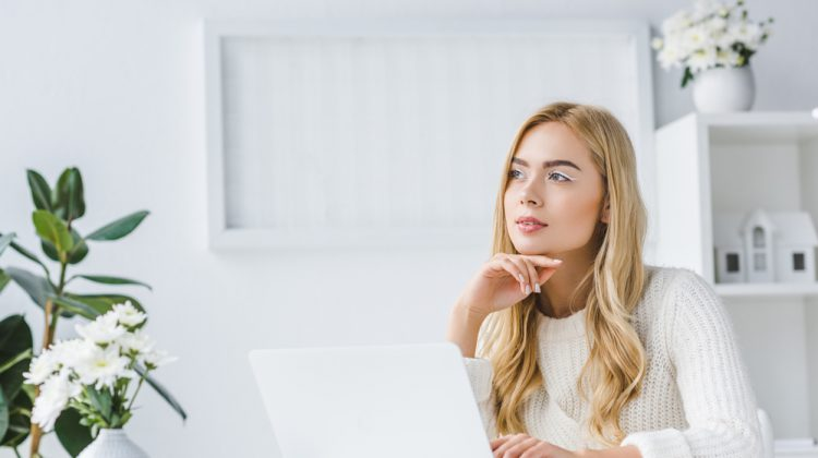 Woman Thinking About Shopping Online