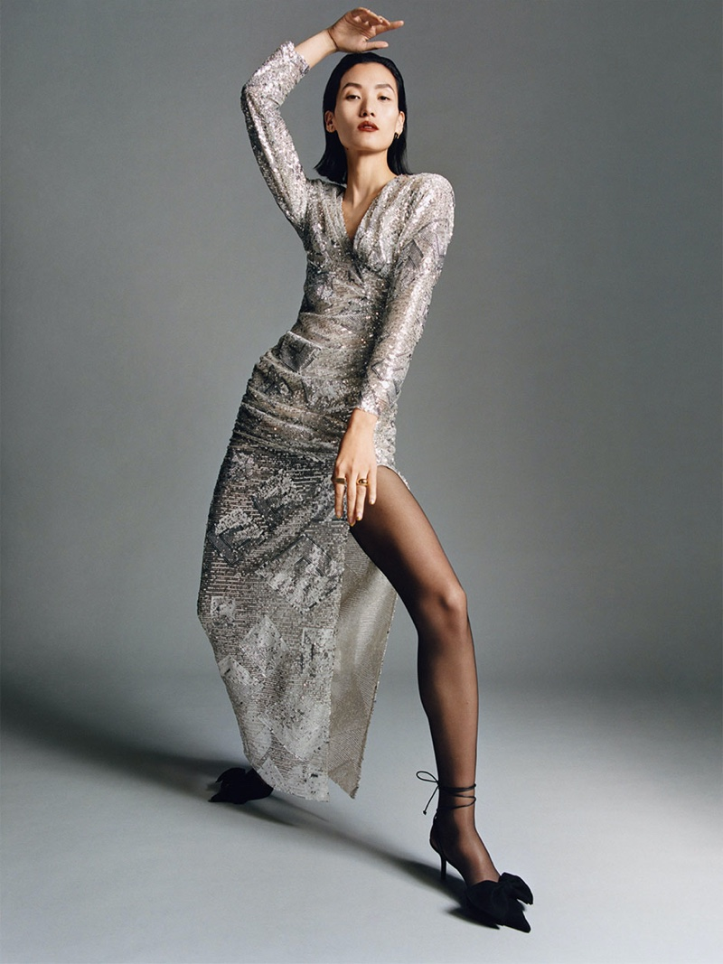 Lina Zhang poses in Zara long sequin dress and Blue Collection tied leather slingbacks