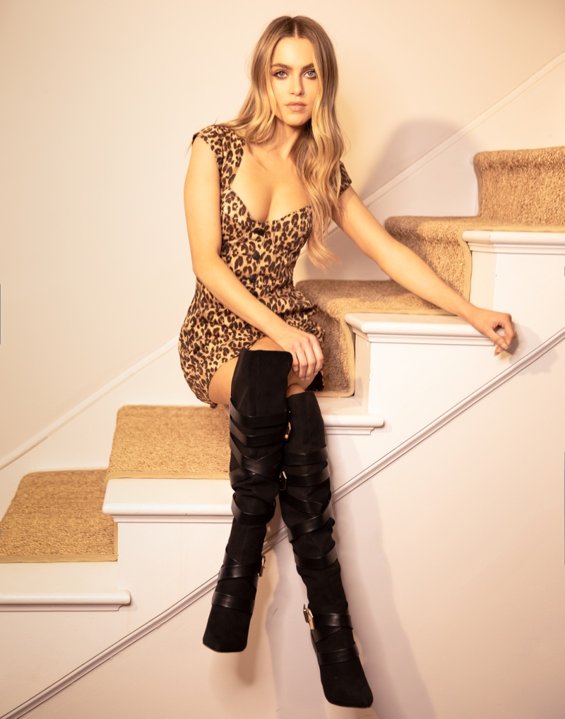 Anne Winters poses in JustFab's winter collection of boots