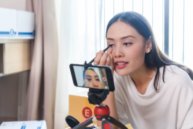 Asian Woman Doing Makeup Camera