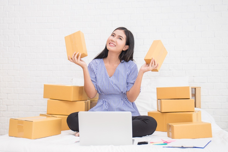 Asian Woman Smiling Boxes Laptop Shopping
