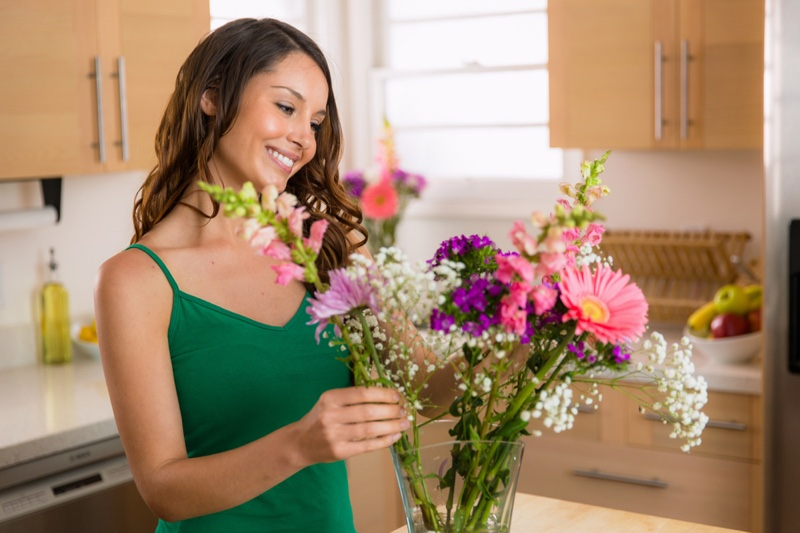 Attractive Woman Arranging Flowers Green Tops