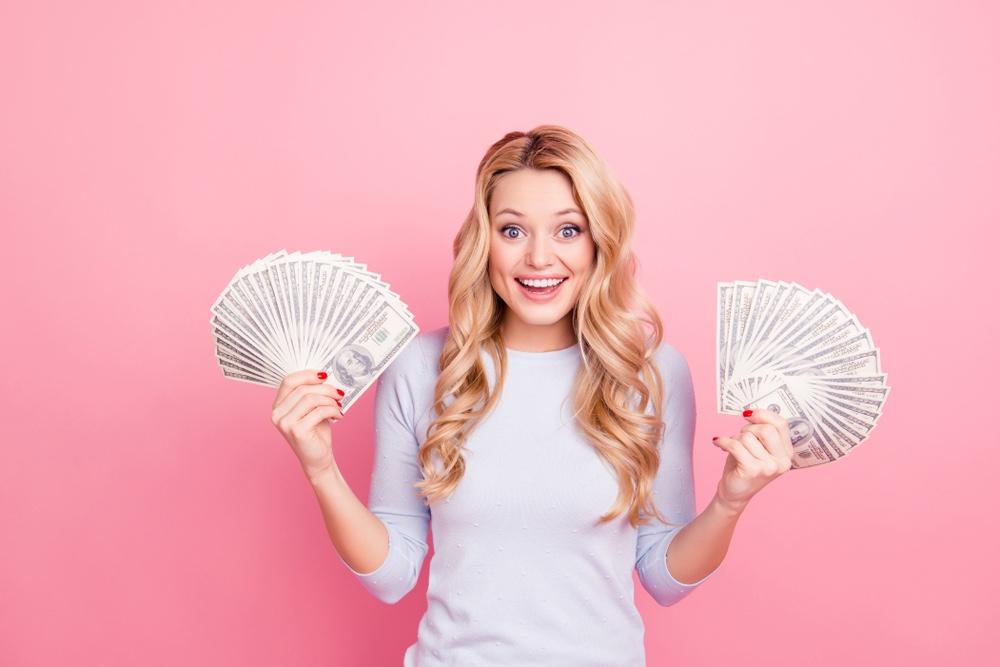 Blonde Woman Holding Cash White Shirt