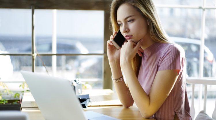Blonde Woman Looking Laptop Phone