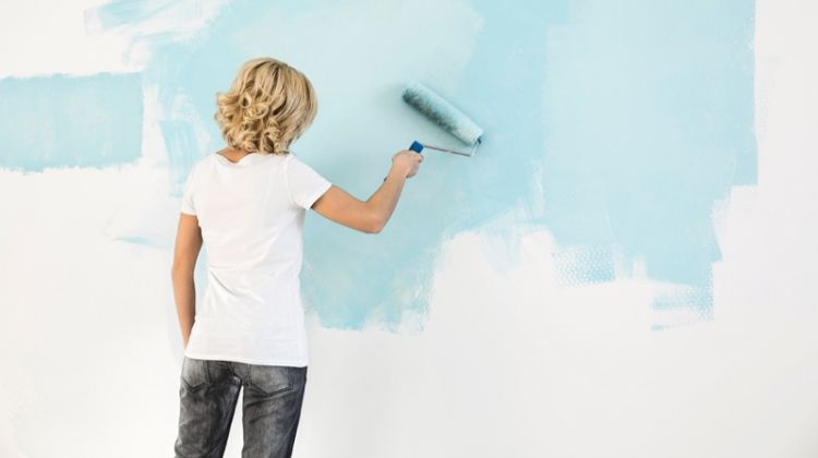 Blonde Woman Painting Wall Light Blue