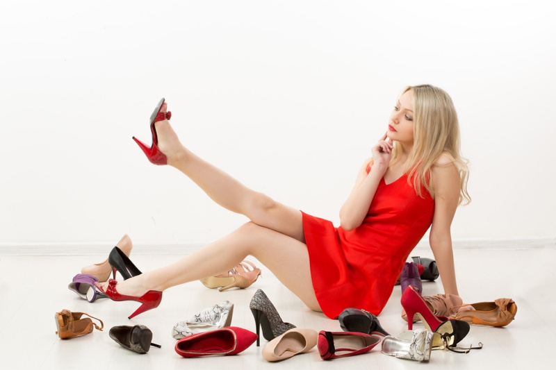 Blonde Woman Trying On Heels Red Dress Thinking