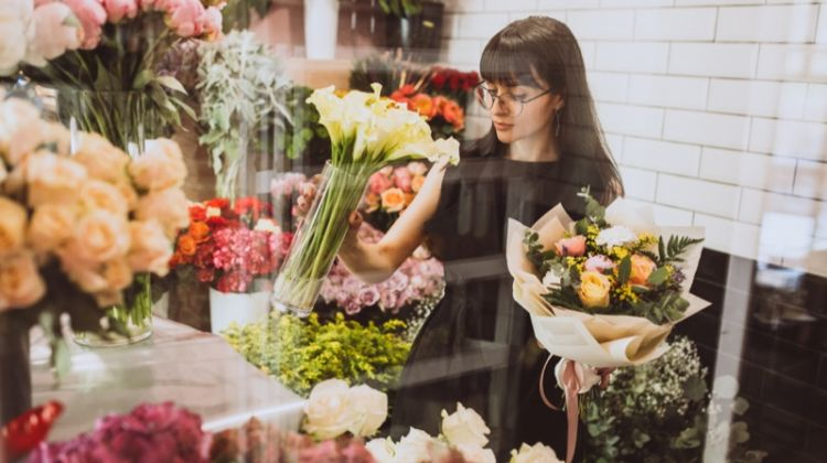 Brunette Woman Holding Flowers Glass