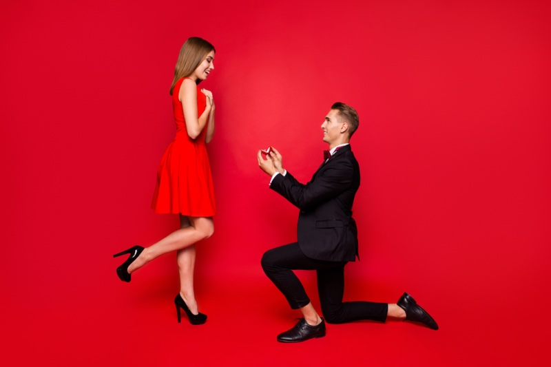 Couple Proposal Man Bended Knee Woman Red Dress