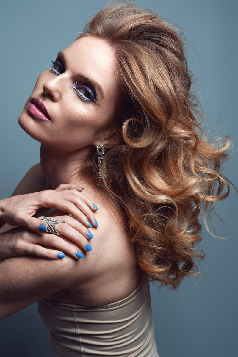 Nell wears Bejeweled earring and ring. Photo: Jeff Tse