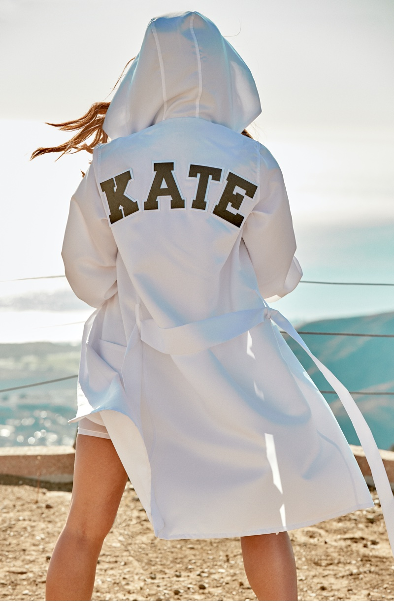 Actress Kate Beckinsale poses in customized robe