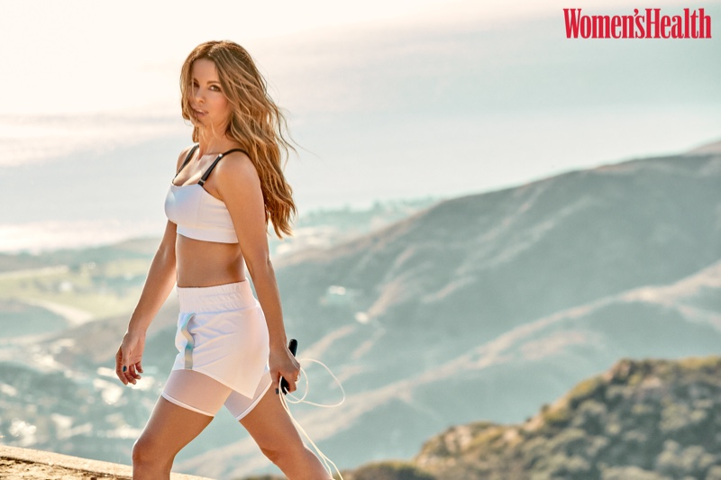 Dressed in white, Kate Beckinsale takes a hike