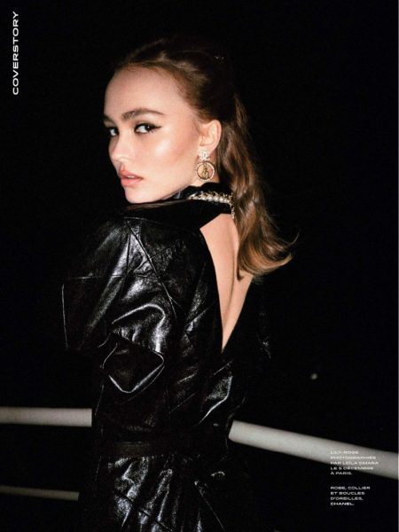 Actress Lily-Rose Depp poses in Chanel dress, necklace and earrings