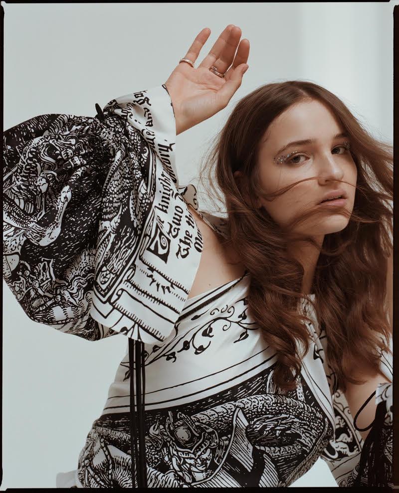 Lisa Vicari wears printed puff sleeve dress