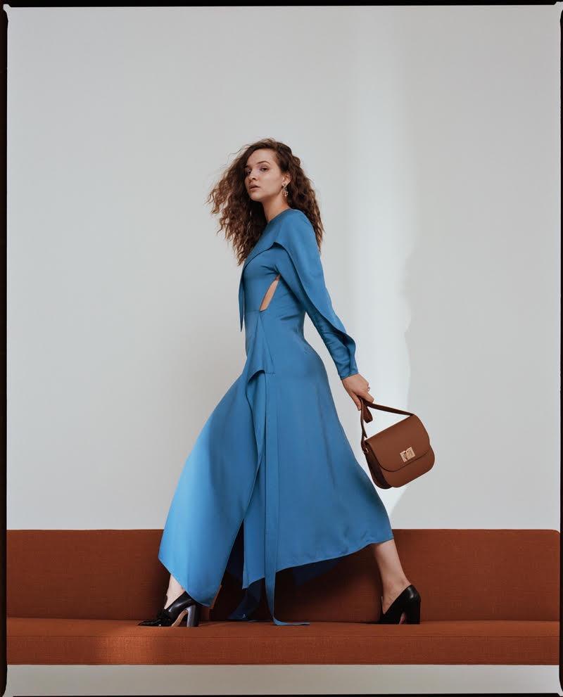 Striking a pose, Lisa Vicari tries on a blue dress