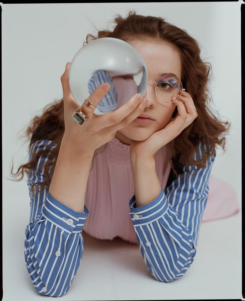 Posing with an orb, Lisa Vicari wears a fashionable look