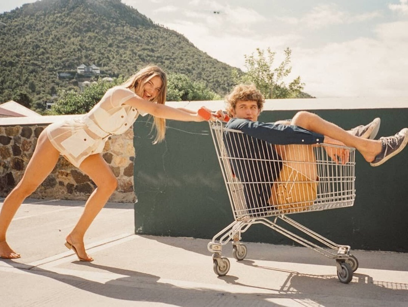 Lorena Rae and Conor Fay pose in Solid & Striped Holiday 2020 collection