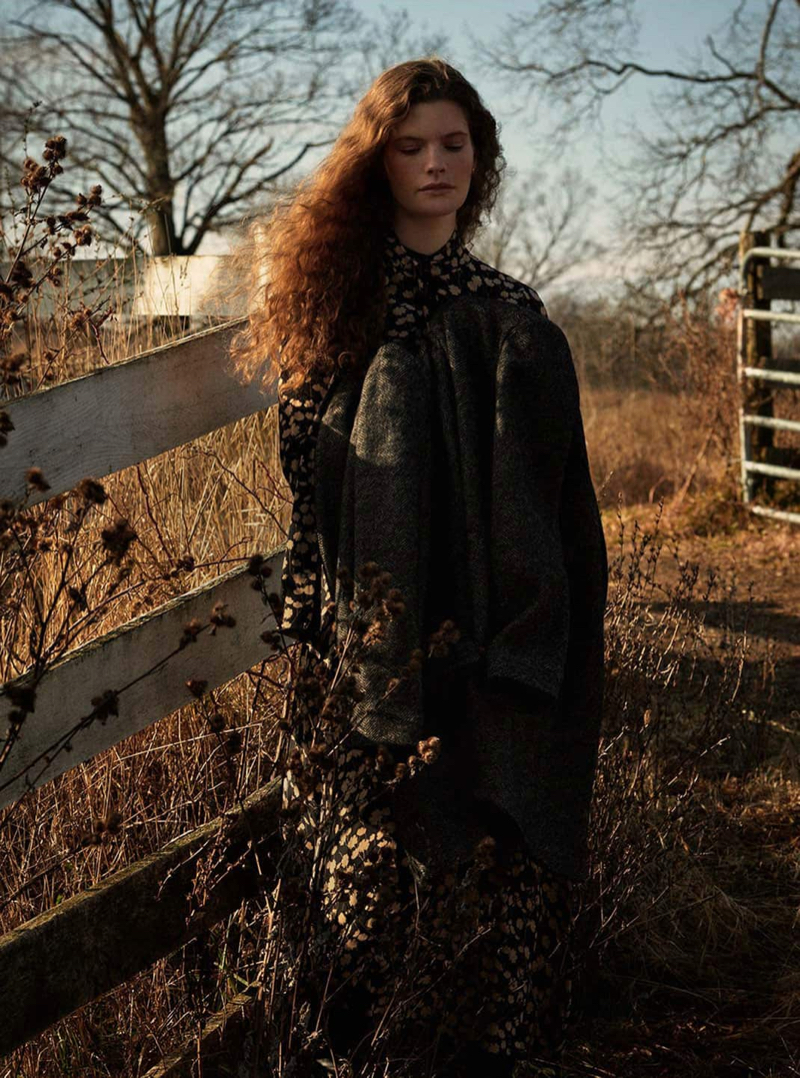 Carolina Burgin poses in Massimo Dutti herringbone cotton and wool coat with floral print dress