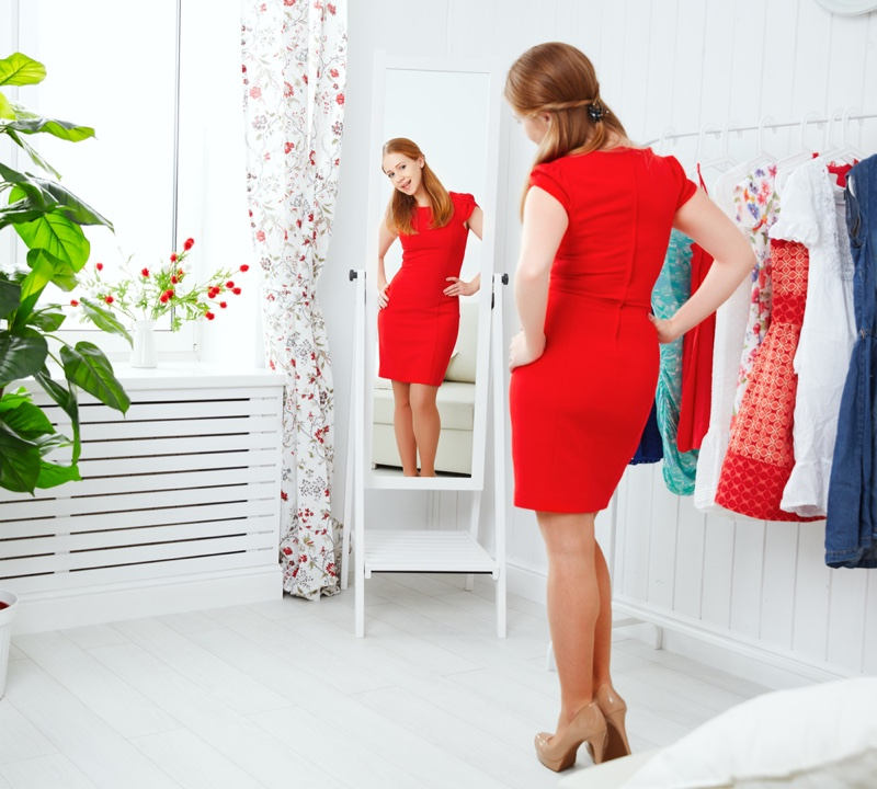 Red Dress Woman Trying On Clothes Mirror