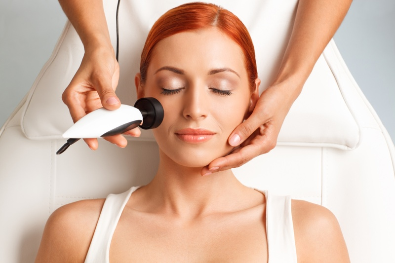 Redhead Woman Radiofrequency Skincare Laser