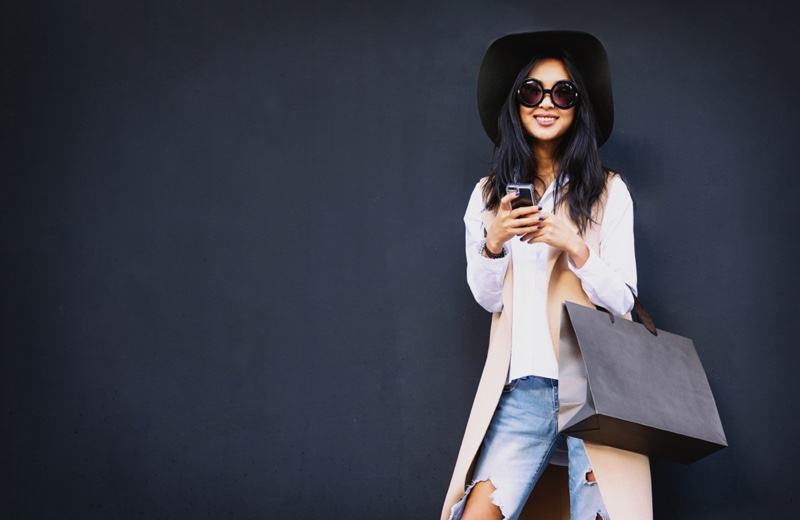 Smiling Woman Shopping Bag Phone Sunglasses Hat Jeans