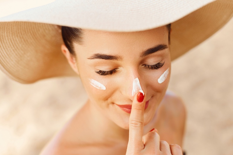 Woman Applying Sunscreen Beach Beauty