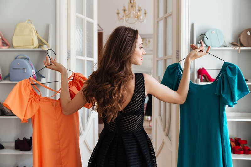 Woman Holding Two Dresses Bags Selection