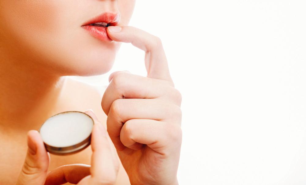 Woman Putting Vaseline on Lips