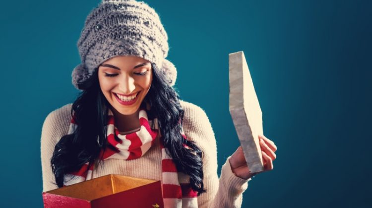 Woman Smiling Opening Gift Christmas Theme Winter