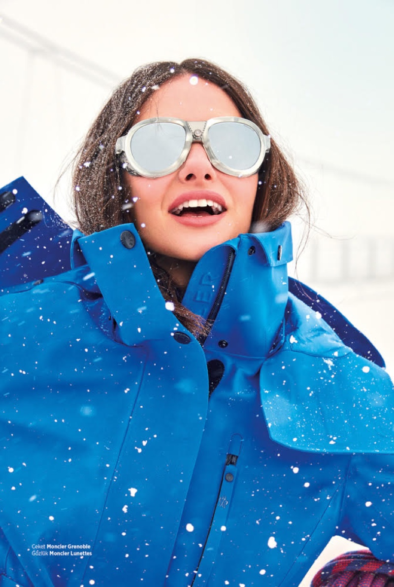 Actress Yasemin Ozilhan wears Moncler Grenoble coat and Moncler Lunettes sunglasses