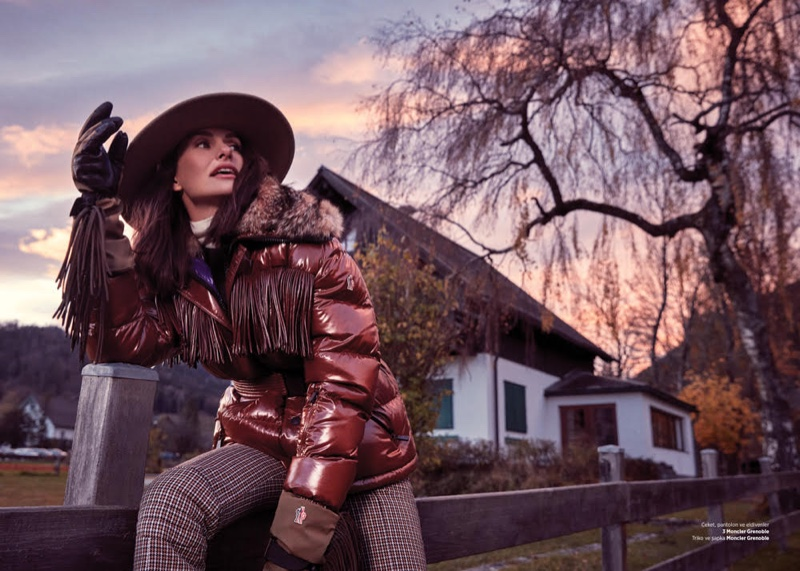 Posing outdoors, Yasemin Ozilhan wears puffer jacket and plaid trousers from Moncler Grenoble