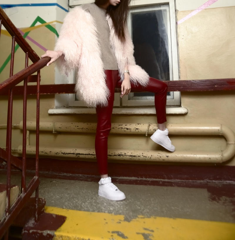 Young Woman Pink Faux Fur Jacket Red Leather Leggings Sneakers