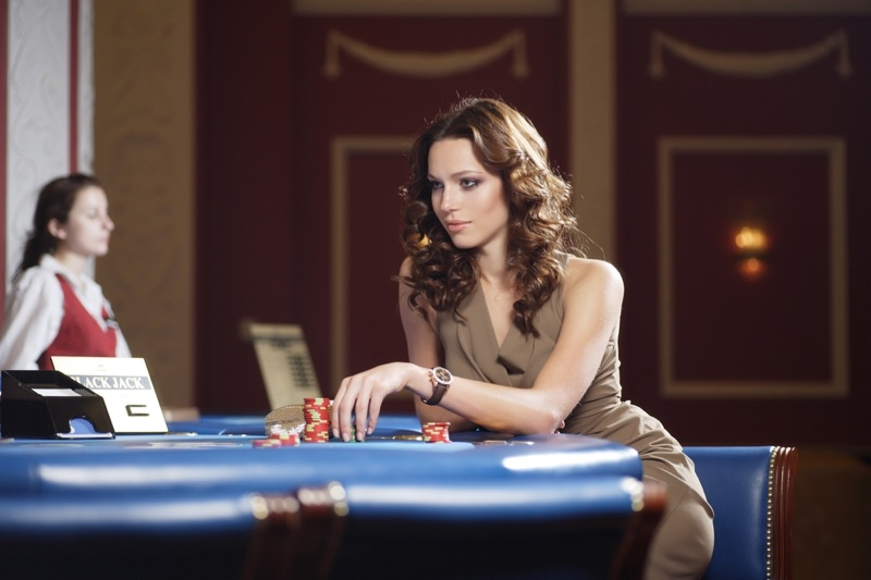 Attractive Woman Casino Chips Brown Dress Wavy Hair