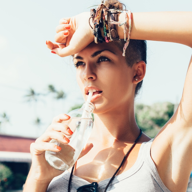 Attractive Woman Drinking Water Bracelets Orange Nails
