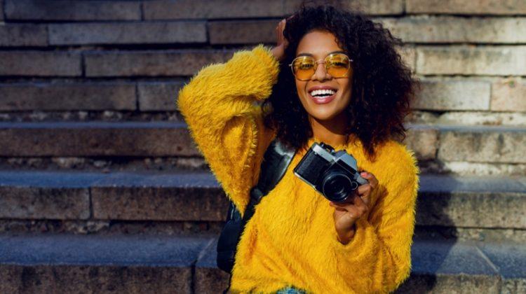Black Woman Yellow Sweater Jeans Camera