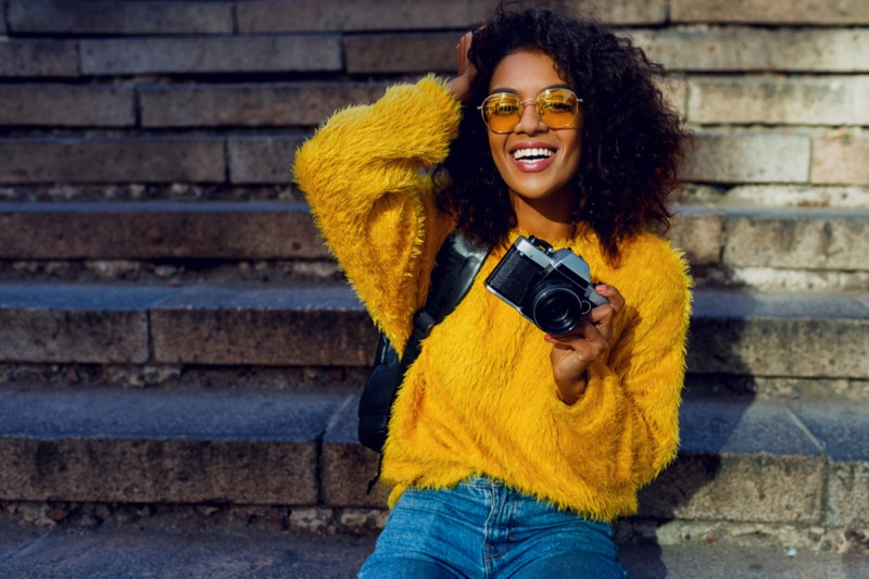 Black Woman Yellow Sweater Jeans Camera