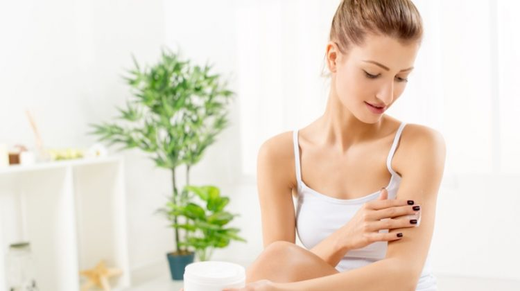 Blonde Woman Applying Lotion Body