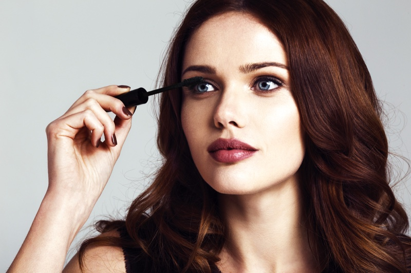 Brunette Model Putting On Mascara