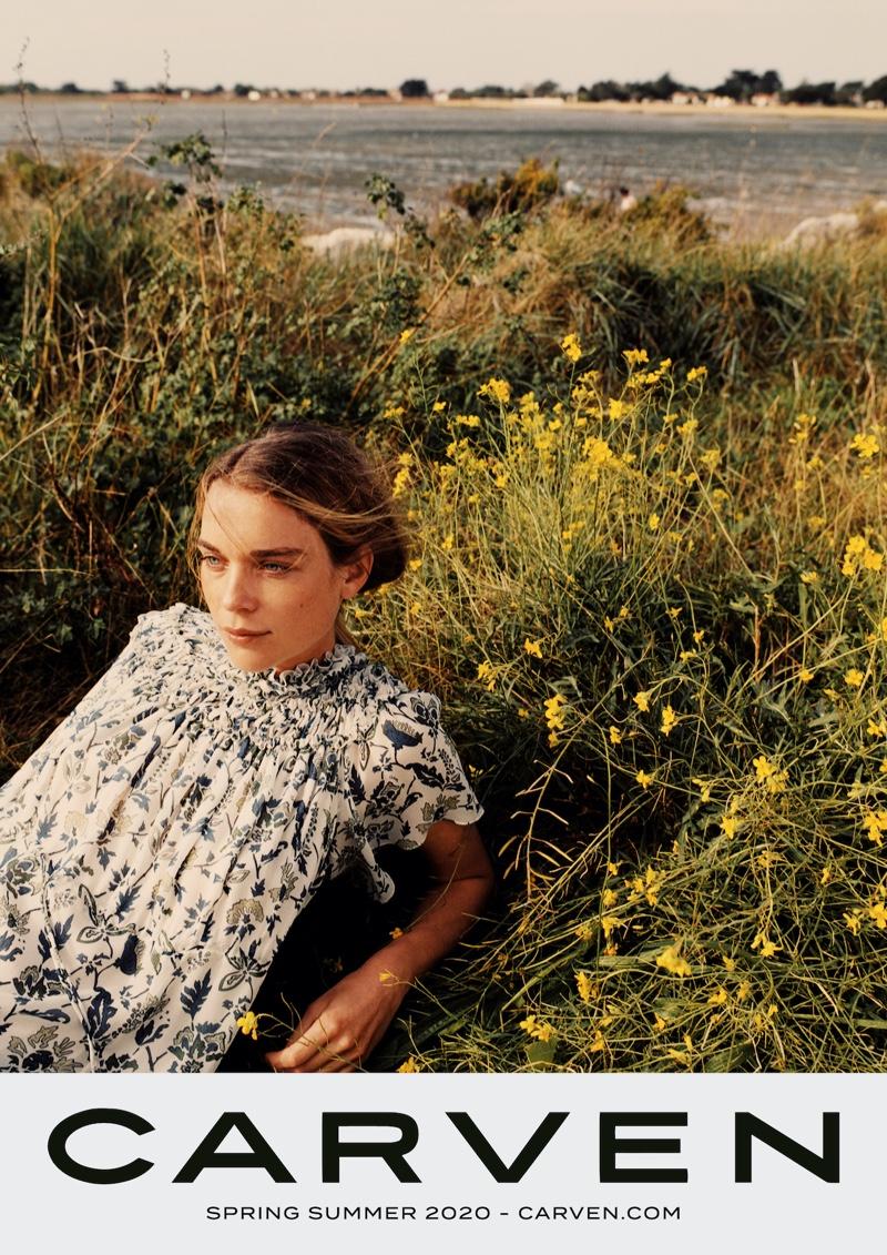 Posing outdoors, Kim Noorda fronts Carven spring-summer 2020 campaign