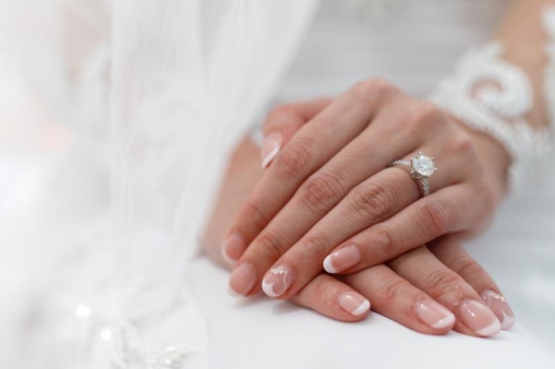 Closeup Bride's Hands Diamond Ring