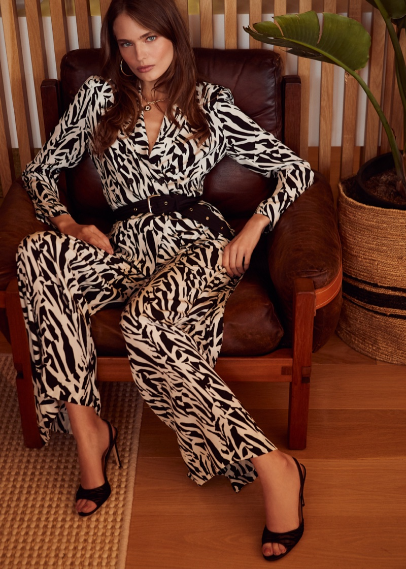 Model Anna Mila Guyenz poses in printed jumpsuit from DVF January 2020 collection
