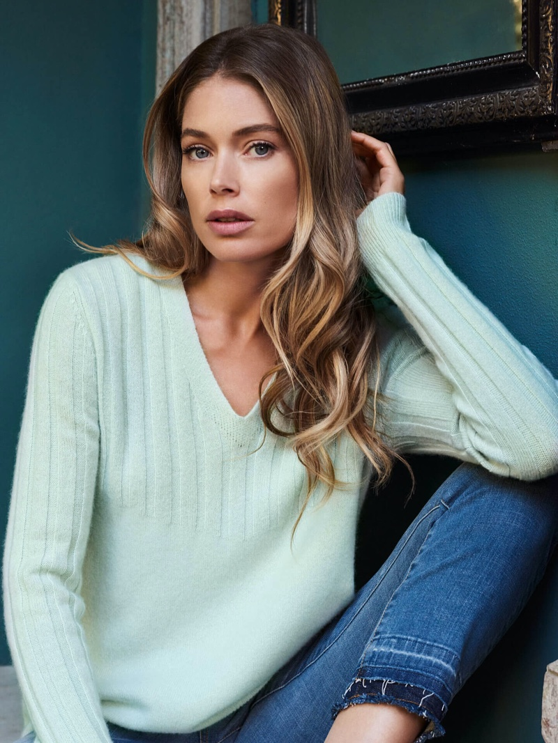 Wearing knitwear, Doutzen Kroes models Repeat Cashmere spring-summer 2020 campaign