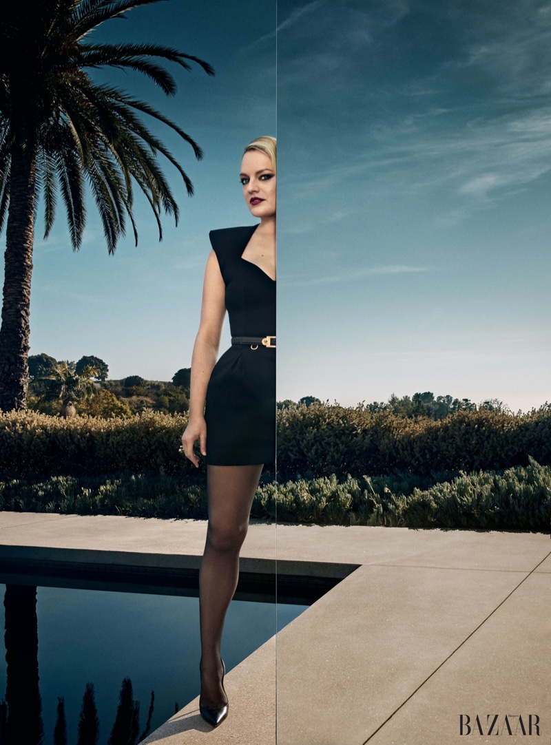 Elisabeth Moss poses in Versace dress and belt with Jimmy Choo pumps