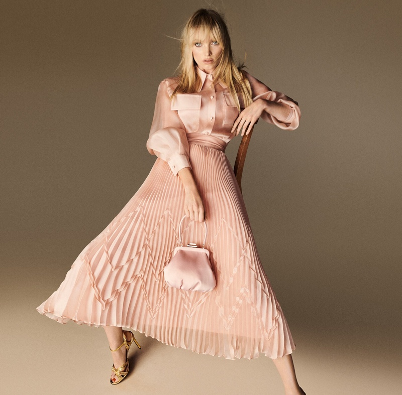 Looking pretty in pink, Elsa Hosk poses for Luisa Spagnoli spring-summer 2020 campaign