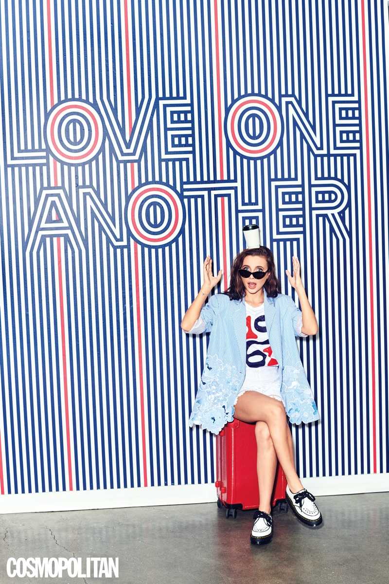 Youtube star Emma Chamberlain wears Vivetta blazer and shorts with Fred Segal top, Dr. Martens shoes and Stella McCartney sunglasses