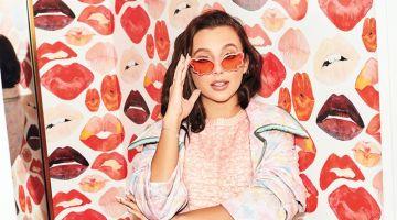 Youtuber Emma Chamberlain wears Fendi jacket, top, skirt and socks with Anna Sui sunglasses